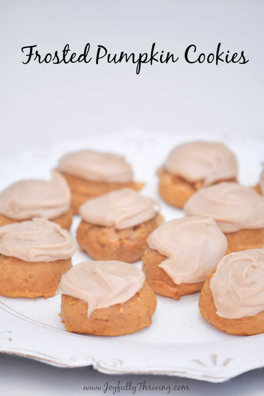 These frosted pumpkin cookies are the perfect fall cookie! A bite sized pumpkin cookie topped with brown butter frosting? Amazing! #pumpkinrecipes