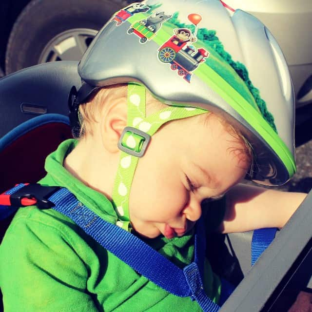 A Tired Boy on His Bike
