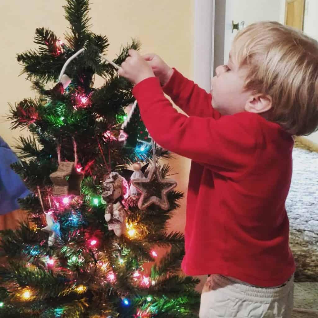 Nathan decorates his own mini tree.