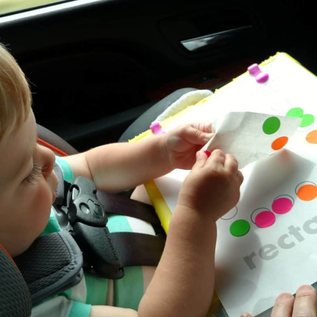 Nathan using garage sale stickers on his do a dot pages