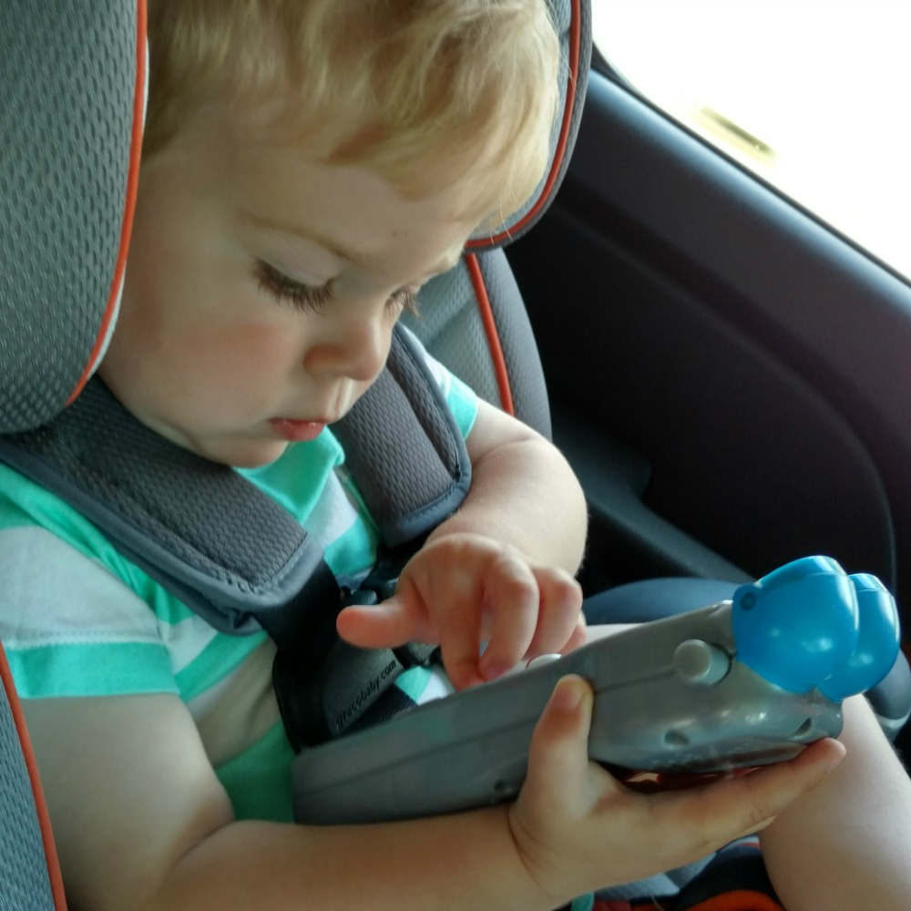 Nathan playing with borrowed toy phone